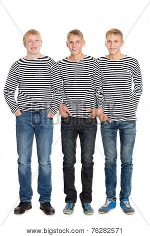 Smiling guys in striped shirts in full growth. Two of the boys twin brothers.