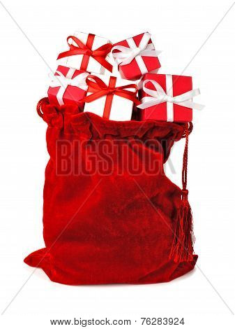 Red bag full of Christmas gifts