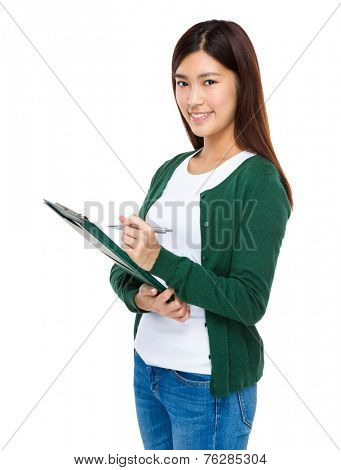 Young woman take note clipboard