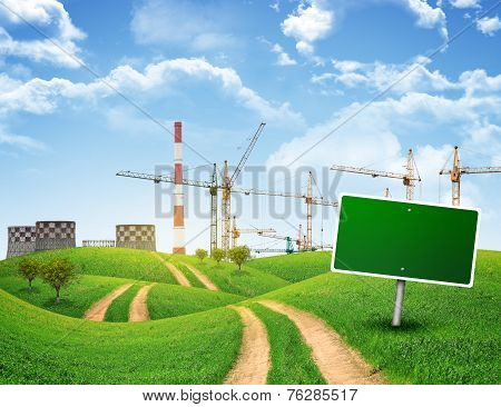 Industrial zone, green hills and road with empty roadsign against sky