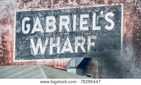 Close up Vintage Signage of Gabriel's Wharf, a Redeveloped Wharf on the South Bank of the River Thames in London.