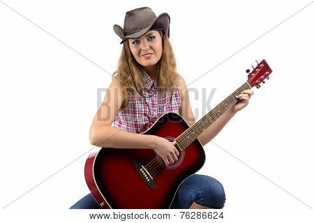 Image of sitting cowgirl with the guitar