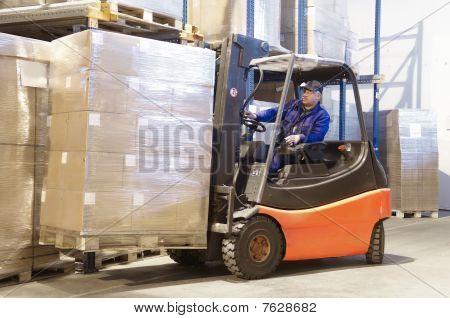Forklift At Work With Driver