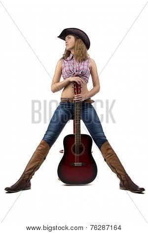 Photo of standing cowgirl with the guitar