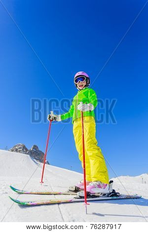 Skiing, winter, ski lesson - young skier on mountainside