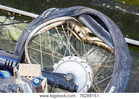 Broken Wheel Of Crashed Motorcycle