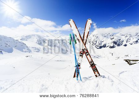 Skiing , mountains and ski equipments on ski run