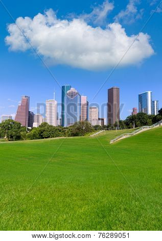Houston skyline sunny day with park turf under blue sky at Texas USA