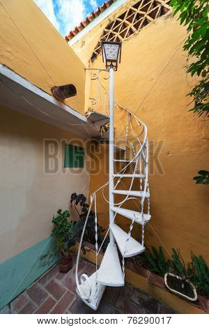 beautiful spiral staircase with a lantern