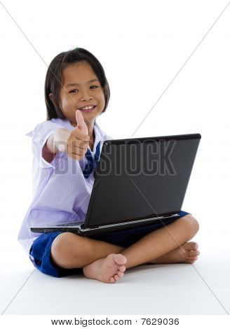 Schoolgirl With Laptop And Thumb Up
