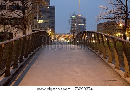 Modern bridge leading from the city to the business center