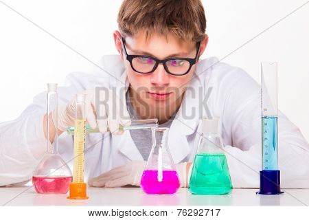 Young Scientist Doing Chemical Reactions In The Laboratory