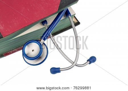 book and stethoscope, symbol photo for bungling, doctors fault and expertise