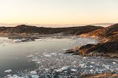 pic of arctic landscape  - Arctic landscape in Greenland around Ilulissat with icebergs and sunset - JPG