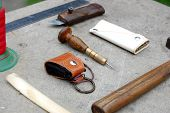 stock photo of leather tool  - Tool for making leather accessories and some of product - JPG