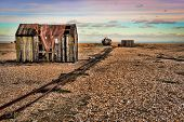 foto of old boat  - Beautiful view of the sea rocky beach with old shed on the pebble beach - JPG