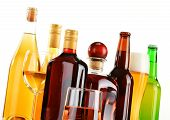 picture of ethanol  - Bottles and glasses of assorted alcoholic beverages isolated on white background - JPG