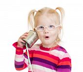 stock photo of tin can phone  - Funny child in eyeglasses using a can as a telephone isolated on white - JPG