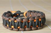 image of paracord  - Two color and double thick knotted paracord bracelet macro
