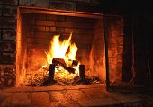 foto of fire  - Old fireplace with warm glow of fire - JPG