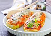 picture of marrow  - stuffed marrow with meat and cheese on plate - JPG