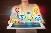 image of presenter  - Young girl presenting a tablet with colorful social icons and signs - JPG
