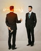 picture of backstabbers  - Angry businessman hiding a weapon behind his back  - JPG