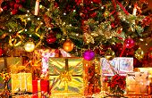 foto of gift wrapped  - Decorated Christmas tree with various gifts - JPG