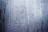 pic of rain  - Rain water and condensation clings to window - JPG