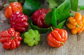 foto of suriname  - Tropical fruit also called Pitanga Brazilian Cherry Suriname Cherry Cayenne Cherry on wooden background - JPG