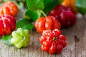 picture of suriname  - Tropical fruit also called Pitanga Brazilian Cherry Suriname Cherry Cayenne Cherry on wooden background - JPG