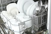 pic of dishwasher  - Open dishwasher with clean utensils in it - JPG