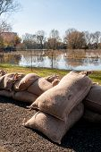 stock photo of sandbag  - barricades of sandbags along the banks of the river - JPG