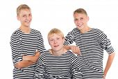 stock photo of conscript  - Group of smiling young men in striped shirt isolated on white background - JPG