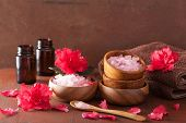 stock photo of azalea  - spa aromatherapy with azalea flowers and herbal salt on rustic dark background - JPG