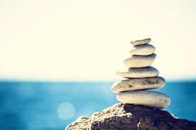 picture of blue  - Stones balance vintage retro instagram like hierarchy stack over blue sea background - JPG