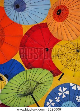 Bright Colorful Oriental Umbrellas Pattern on Yellow Background