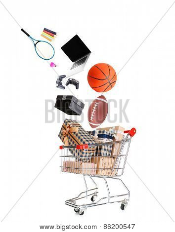 Sport goods falling into cart isolated on white
