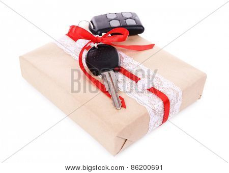 Car keys with red bow on present box isolated on white
