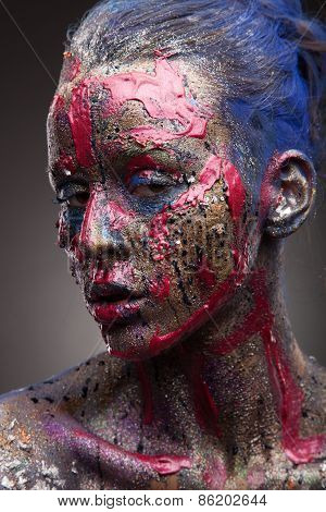 Sensual girl with colorful bodyart and face art