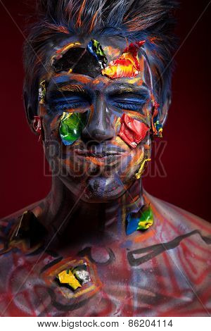 A creepy portrait of halloween moor with colour body art.