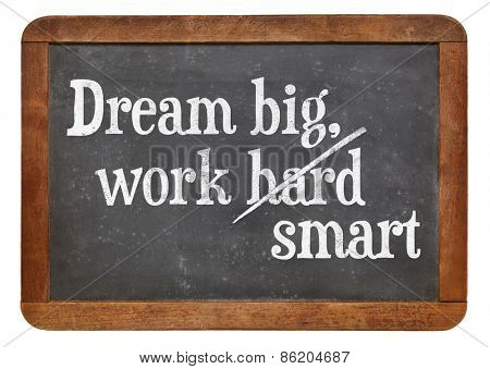 Dream big, work smart.  Motivational words on a vintage slate blackboard