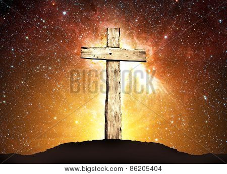 One wooden cross and background from space with stars and sunlight. Elements of this image furnished by NASA