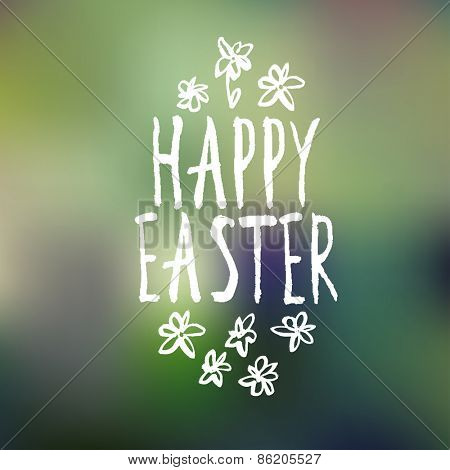 Easter Greeting on Blurred Green Background