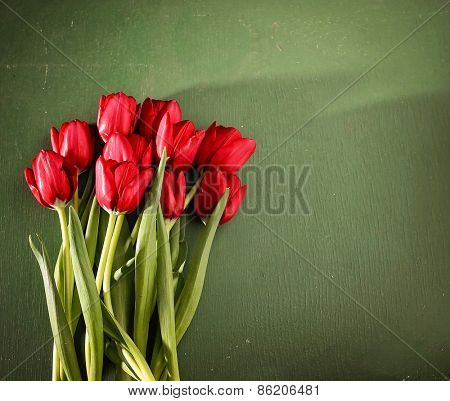 tulips on a wooden board. good for mother's day, easter, valentine's day or other holidays symbolizing love
