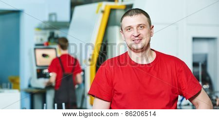 manufacture technician worker portrait at factory metal machining shop