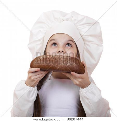Little girl in cook hat looking up, isolated on white background