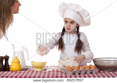 Happy mother with little daughter joyful cooking, isolated on white background