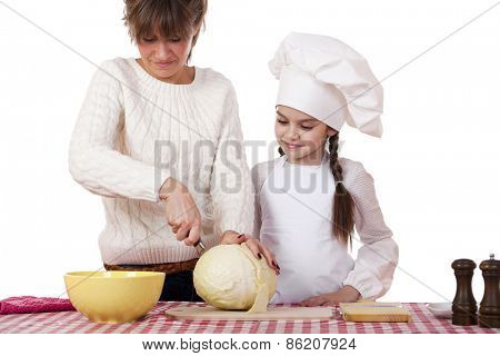 Cooking and people concept - Little girl in cook hat and mother, isolated on white background