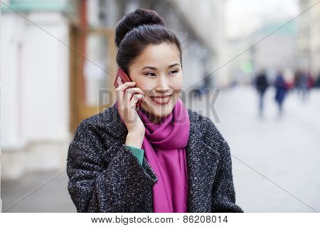 Asian beautiful girl calling by phone in spring street